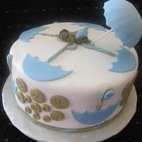 Cute As A Button  Baby shower cake with umbrellas and buttons. Was a last minute request from a friend of mine and since I had the baby mold I figured I...