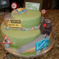 Over The Hill 40th birthday cake, inspired by others similar. The birthday boy races cars similar to the one on the cake.