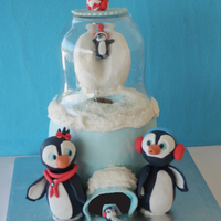 Penguin Family Snow globe cake with a penguin family having fun on snow!