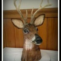 Deer Hunter Grooms Cake antlers and ears made from modeling chocolate