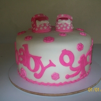 Baby Girl   Double chocolate cake with butter almond filling. Shoes made with fondant strengthened with Tylose.