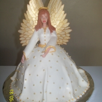 My Guardian Angel   Marble cake covered in fondant w/ gold dragees and wings made of rice paper and coloured with gold dust.