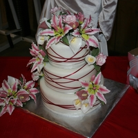 Lilies Cake was Confetti with strawberry cream filling (Brides choice) Fondant was the best I have ever worked with (made by Goodies) and the best...