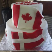 Canadian And Danish Flags   Cake was made for a Man who is turning 50 and has a Canadian and danish flags tattooed on his arm.