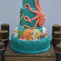 Octopus Cake  I made this cake for the 2014 Washington State Cake Show. The corals are made from fondant and gum paste. Most were hand molded but I did...