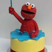 Elmo Cake Modeling chocolate and rice cereal treat elmo topper for birthday cake. Techniques learned from Lauren Kitchens