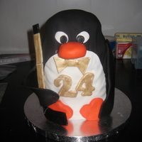 "Penguin Cake Penguin cake made for a woman's boyfriend on his ""golden"" birthday. He loved Penguins and Hockey...thus the Penguin with a..."