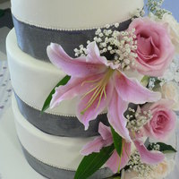 Round Cake With Silver Ribbon And Fresh Flowers  This is a all lemon cake, iced in buttercream. For the ribbon I first did fondant and than regular ribbon to prevent greasy look:) The...