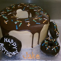 Donut Cake White cake with chocolate mousse filling, buttercream frosting, topped with chocolate ganache. Sprinkles were made out of royal icing. The...