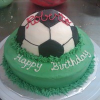 Soccer Ball Birthday White cake with strawberry mousse filling and buttercream frosting.