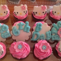 Hello Kitty Cupcakes Vanilla and chocolate cupcakes with swiss meringue buttercream and fondant accents