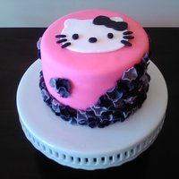 Hello Kitty Ruffles  A 6 inch carrot cake with cream cheese icing for a small birthday cake. I wanted to keep the Hello Kitty theme looking a little more grown...