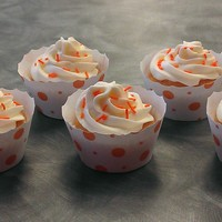 Orange Creamsicle Cupcakes Orange Creamsicle Cupcakes, so an orange base with a classic vanilla buttercream on top. Accented with the orange polka dot wrappers and...