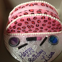 "Leopard Make Up Bag half 10"" vanilla cake with vanilla icing, covered in mmf, pearl borders, airbrushed pink, hand painted leopard prints. accessories..."