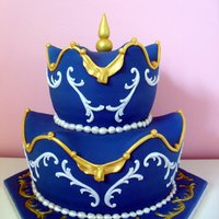 Hilarion - Wavy Cake  This is a blue wavy cake :)The groom asked me to include his wifes necklace in this cake, so I made an example of fondant and then I made a...