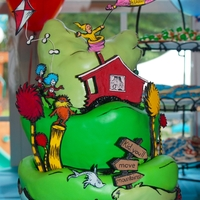 Dr. Seuss Cake  A Dr. Seuss cake for a little boy's first birthday. Characters/house/trees/balloon/kite are hand cut out of gumpaste and handpainted....
