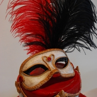 Mardo Gras Wedding Cake A cake that I made for a Mardi Gras themed wedding. I made the mask out of sugar/gum paste. One tier is a Red Velvet cake and the other a...