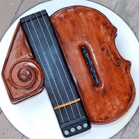 """40"" Th Birthday Violin Cake A sculpted violin theme cake for a ""40"" th birthday. Chocolate cake with layers of Vanilla Italian Meringue Buttercream."