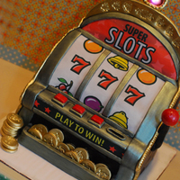 Slot Machine Cake Slot Machine Cake. All edible including coins which are made from sugar. The top jackpot light blinks. Red Velvet cake with Vanilla Italian...
