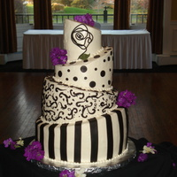 Black And White Topsyturvy All Buttercream iced... Fondant decorations... Fresh flowers. This was my 2nd topsy turvy cake... I was happy with how it turned out, was...