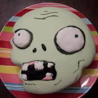 Plants Vs. Zombies Character Cake I created this for my son's 5th birthday. Carved from a stencil I traced onto parchment paper and covered in MMF. Food writer markers...
