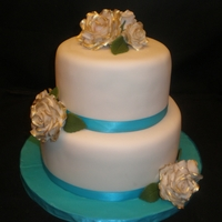 Roses 8 and 6 inch cake with handmade roses from gumpaste