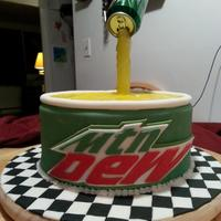 Mountain Dew Cake   Mountain Dew cake with the effect of soda pouring out of the can. This was my favorite cake to make!!