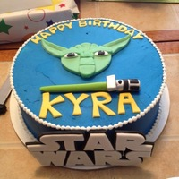 Star Wars Cake   Chocolate cake frosted in butercream. All decorations are made out of fondant.