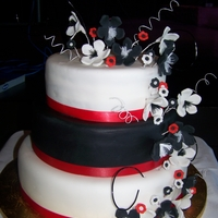 Red, White, And Black Wedding Cake  Red velvet cake with raspberry b/c. All fondant. She wanted to add in gold cause her husband is in the military but didn't want to...