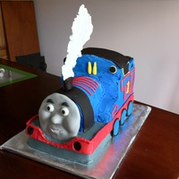 Thomas Cake Thomas Cake made out of 11x15 sheet cake and a cupcake. I really like how the smoke looks.