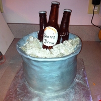 Beer Cake #1 Bucket is the cake. Bottles are edible hard sugar made with a mold.