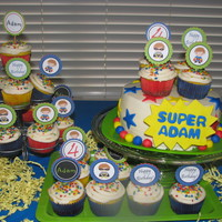Superhero WASC cupcakes and chocolate chocolate chip cake with buttercream icing and MMF decorations, star sprinkles. Got the cute cupcake picks on...