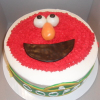 Elmo Birthday Cake And Cupcakes WASC cake with BC and MMF decorations. Cupcakes are chocolate with mocha fudge filling and BC.