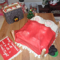 Santa And Mrs. Claus Settle Down For A Long Winter's Nap! Red velvet cake, cream cheese frosting, MMF, gumpaste. Placed on a wooden cutting board for the look of wood floors. The fireplace and bed...