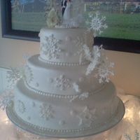Snow Flake Wedding Cake snow flakes are made of royal icing the cake is covered in buttercream