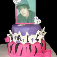 Justin Beiber Birthday Cake Two Tier Cake. Justin Beiber is an edible image in a gumpaste frame. The stars spell out the Birthday Girl's name.