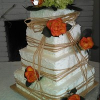 "A 4 Tier Square Wedding Cake 12 10 8 Amp 6 Chocolate Cake With Chocolate Mousse Filling And White Cake With Vanilla Mousse Fill A 4 tier Square Wedding Cake (12"", 10"", 8"", & 6""). Chocolate cake with chocolate mousse filling, and White cake..."