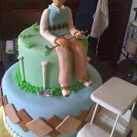 Golfer 94 year old fondant golfer on an argyle chocolate cake bottom with a RKT golf cart covered in fondant.