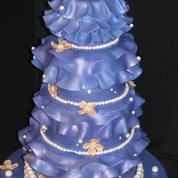 Fantasy Dogwood & Pearl Cake A Marina Sousa design I tried to recreate for a client. They loved it. I hope I did Marina proud. She is one of my favorite cake designers...