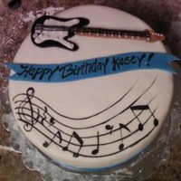 Guitar Birthday Cinnamon swirl with cream cheese icing. Covered in marshmallow fondant. The recipients wife wanted a guitar and also a music staff with the...