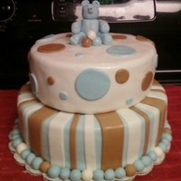 Blue/brown Teddy Bear Shower Chocolate peanut butter ganache covered in marshmallow fondant.