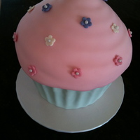 Giant Cuppy Vanilla butter cake with vanilla buttercream and covered in fondant.