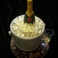 Champagne Bottle In Ice Bucket Ice bucket made from vanilla sponge, champagne bottle modelled from belgian modelling chocolate and hand painted, clear mints used for the...
