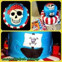 Arrrh! Pirate's Birthday 1 tier red velvet, the other vanilla, both with vanilla buttercream. Fondant decorations