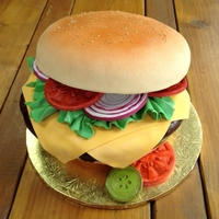 Say Cheeseburger!  I can has cheezeburger with vanilla cake buns and chocolate cake burger, fondant lettuce, cheese, tomatoes, onions and pickles on a toasted...