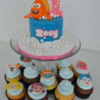 Bubble Guppies Cake And Cupcakes  This Bubble Guppies cake and cupcakes were created for a little girl's first birthday. Mr. Grouper is made out of Rice Crispy Treats....