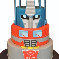 Transformer's Birthday Cake Optimus Prime birthday cake for a seven year old. Thank you to the many transformer cakes for inspiration especially Tuff Cookie cakes by...