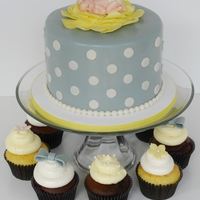 Gray And Yellow Baby Shower Cake And Cupcakes  Baby shower cake and cupcakes for a gray and yellow themed baby shower. The baby is made with a mold. Inspiration from a cake by One Sweet...