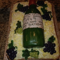 "My Husbands 65Th Birthday Cake Straw Is White Chocolate And The Grapes Are Marzipan Wine Bottle Is Also Cake With Edible Sugar Sheet my husbands 65th birthday cake, ""straw"" is white chocolate, and the grapes are marzipan. Wine bottle is also cake with edible..."