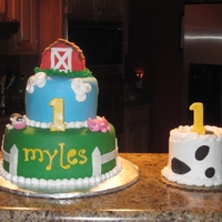 "1St Birthday Farm Theme 5"" & 8"" round covered in fondant and fondant decorations. cow & pig were made out of fondant as well."